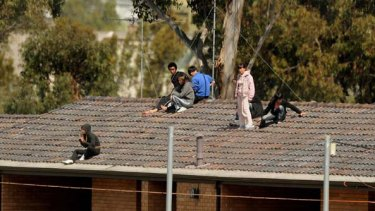 Nine on the roof ... fresh rooftop protest breaks out at Villawood detention centre.