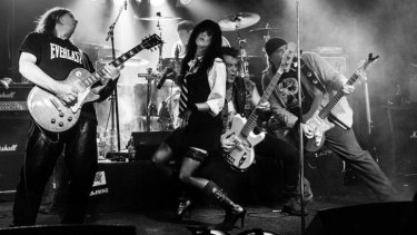 Donna Greene (centre) was performing at a Chrissy Amphlett tribute concert when her leg collapsed beneath her - a symptom of multiple sclerosis.