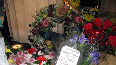 Forever remembered ... a bouquet of flowers sits alongside the wreaths as a simple tribute to a fallen soldier.
