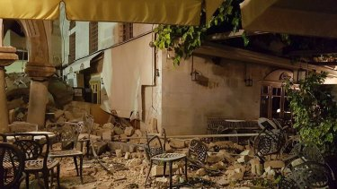 A cafe setting is littered with rubble following a strong earthquake on the Greek island of Kos early on Friday.