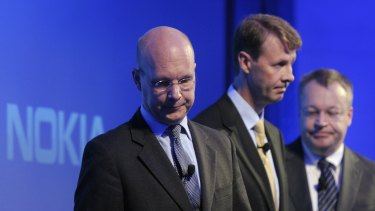 Unhappy campers: Nokia's new CEO Timo Ihamuotila, Nokia's Chairman of the Board Risto Siilasmaa and former Nokia CEO Stephen Elop face the media.