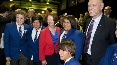 Prime Minister Julia Gillard and Minister for School Education, Early Childhood and Youth Peter Garrett pose for pictures with students before the public forum.