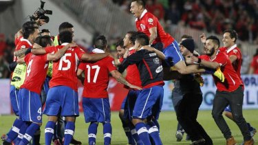 Chilean players celebrate qualifying for the 2014 World Cup after the final whistle in Santiago.