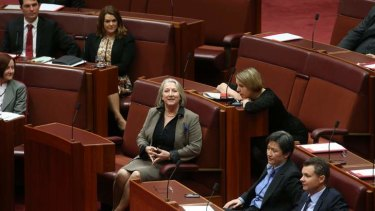 Liberal Senator Sue Boyce sits with ALP Senator Louise Pratt to vote in favour of recognising  international same sex marriages on Thursday.