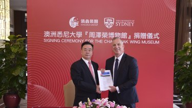 Dr Chau Chak Wing and vice-chancellor of the University of Sydney Dr Michael Spence in Guangdong, China, shaking hands on the gift to build the Chau Chak Wing Museum.