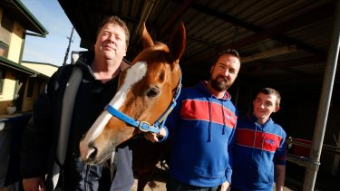 Big-hearted: Single Gaze with trainer Nick Olive, part-owner Martin Hay and foreman Billy Owen.