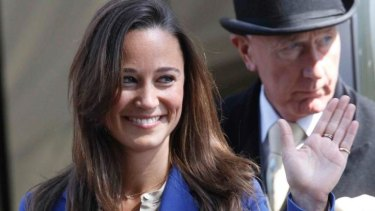 Pippa Middleton waves as she leaves The Goring hotel, in central London.
