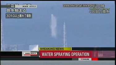 A television image of the helicopter water bombing the plant.