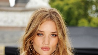 "The price of beauty ... are good-looking people like lingerie model and actress Rosie Huntington Whiteley, above, ""worth"" more?"
