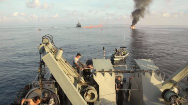 Fire down below ... 15 minutes after the explosion on the asylum seeker's boat.