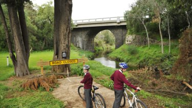Daniel and James Jones at the end of the Darebin Creek path, beyond which lies private land.