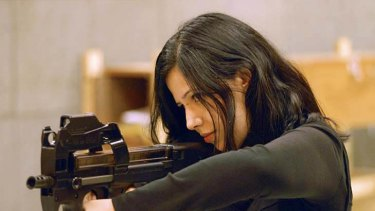 Jalila Essaidi pointing a gun at a target at an undisclosed location.