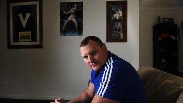 Former Brisbane, Essendon and Melbourne AFL player John Fidge at home in Adelaide.