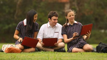 Seat of learning ... Chatswood High School students with their laptops, from left, Samantha, Daniel and Rachel.