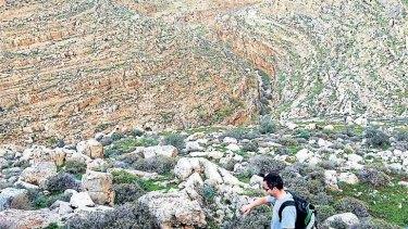 A walker in Wadi Auja, near Jericho in the Israel-occupied West Bank.
