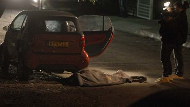 Gunned down outside his home: the body of Andis Hadjicostis lies on the street.