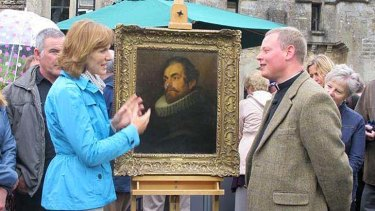 A valuable find: <i>Antique Roadshow's</i> Fiona Bruce and Father Jamie MacLeod with the portrait.