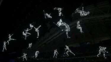 Performers at the opening ceremony mimic the sports that should be the centre of the Games.