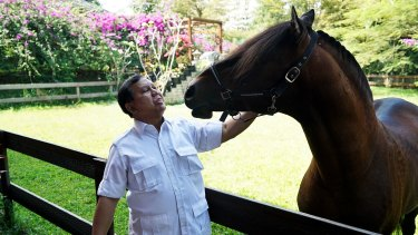 Prabowo Subianto with his horse.