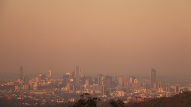 The smoke from the Sunshine Coast bushfire hung over Brisbane on Friday evening.