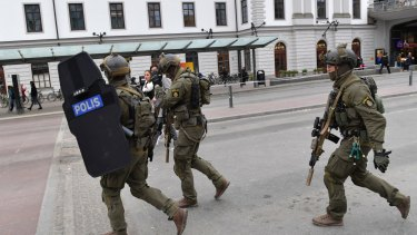 Heavily armed police arrive in central Stockholm.