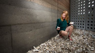Collaboration: Curator Kirsha Kaechele inspects some of the oyster shells forming part of her museum's Heavy Metal Retaining Wall.