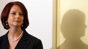 Australia's Prime Minister Julia Gillard waits to make a speech.