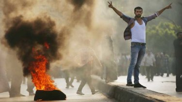 Supporters of former Egyptian president Mohammed Mursi burn tyres along a bridge in protest over his removal by the Egyptian military.