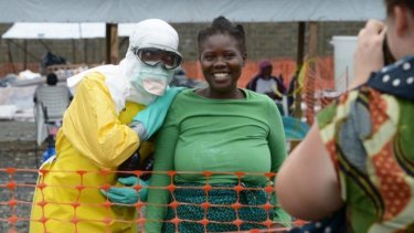 A health worker and a woman pose inside the high-risk area at Elwa hospital in Monrovia.
