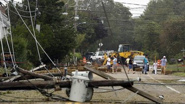 Residents inspect fallen power lines in Hampton Bays, New York.