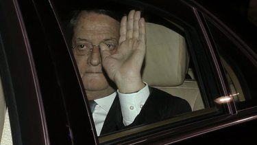 Deal struck ... Cyprus' President Nicos Anastasiades waves as he arrives at the presidential palace in Nicosia.