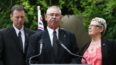 Corporal Baird's father Doug is comforted by his wife Kaye and son  Brendan as the family address the media.