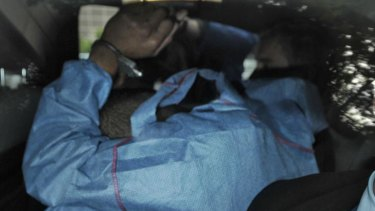 Acar is transported to court last year.