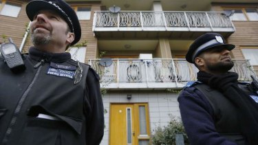 """Trapped by monster"": police stand guard at the flat in Brixton."