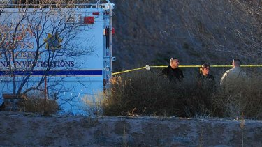 Multiple deaths ... police search for evidence.