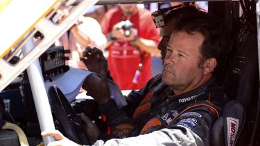 Robby Gordon of the US and co-pilot Johnny Campbell prepare to begin the 10th stage.