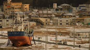 Permanent reminder: a fishing boat washed ashore by the tsunami sits in a deserted port area in Kesennuma, Miyagi prefecture, northeastern Japan, at dawn on Monday 11 March, 2013.
