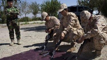 Weapons drill: Female Peshmerga recruits assemble AK-47 rifles during training near Sulaimaniya.