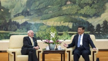 Former Australian prime minister John Howard (left) meets with Chinese President Xi Jinping in Beijing on Wednesday.