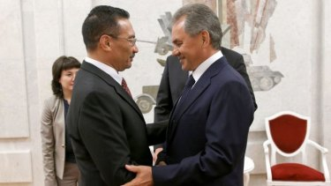 Russian Defence Minister Sergei Shoigu (right) welcomes his Malaysian counterpart Hishammuddin bin Tun Hussein (left) in Moscow.
