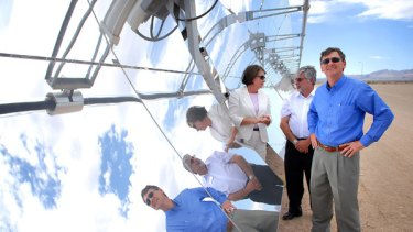 Sun day: Queensland Premier Anna Bligh and John Brumby (right) tour Nevada Solar One's facility yesterday with the company's vice-president of operations, Gilbert Cohen. PICTURE: JACOB KEPLER