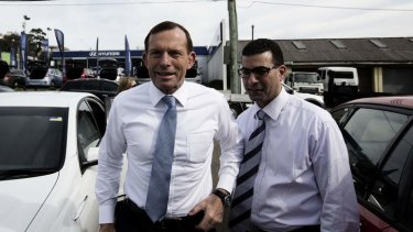Campaign trail: Tony Abbott with Nickolas Varvaris, then Liberal candidate, now MP for Barton in Sydney. He unwittingly voted with Labor in Parliament on Wednesday after some conjecture of his state of wakefulness.