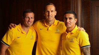 In reach of their goal: Lucas Neill, Mark Schwarzer and Tim Cahill.