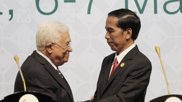 Indonesian President Joko Widodo, right, shakes hands with Palestinian President Mahmoud Abbas after delivering their closing remarks at the Organisation of Islamic Cooperation (OIC) summit in Jakarta on Monday.