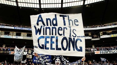Geelong fans celebrate at the 2009 grand final.
