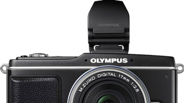 Olympus PEN E-P2: sweet compromis between size and quality.
