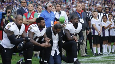 Members of the Baltimore Ravens take a knee on Sunday at Wembley, London.
