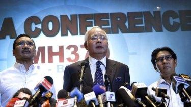 Malaysian Prime Minister Najib Razak, centre, addresses the media.