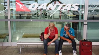 Grounded ... a Qantas captain suspected of drinking before her shift last Monday. Above, delayed passengers.