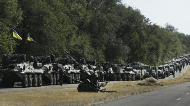 Ukrainian soldiers park their hardware on the roadside as they wait for the start of the march into the town of Mariupol, eastern Ukraine.